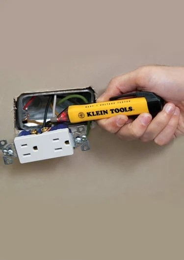 Using voltage tester