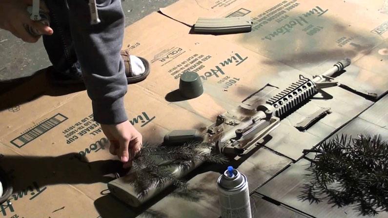camouflaged gun
