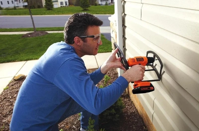 A man drilling with the LD120 drill/driver