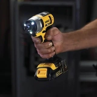 A hand holding a Dewalt Impact Driver