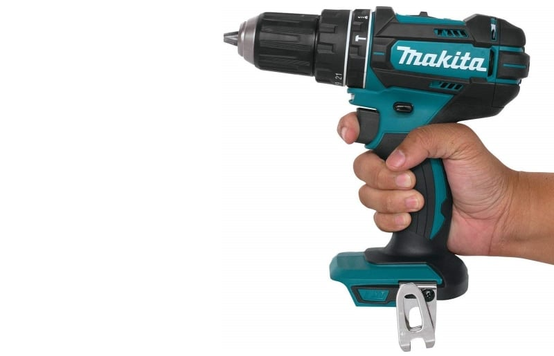 Hand holding a Makita Hammer Driver Drill