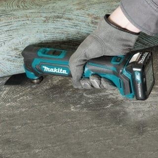 A hand working with Makita MT01R1
