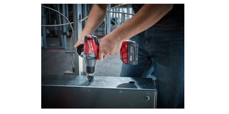 A man working with 2704-20 Milwaukee tool