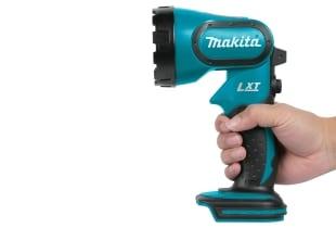 Hand holding Makita Xenon flashlight