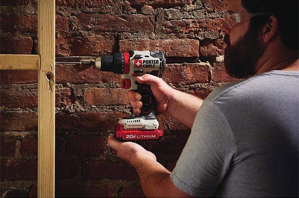 Man Using PCCK607 Brushless Drill