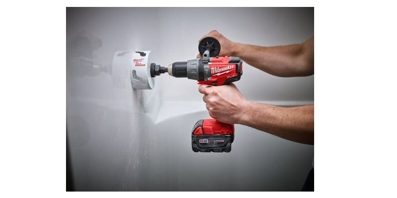 A hand working with Milwaukee Impact Driver
