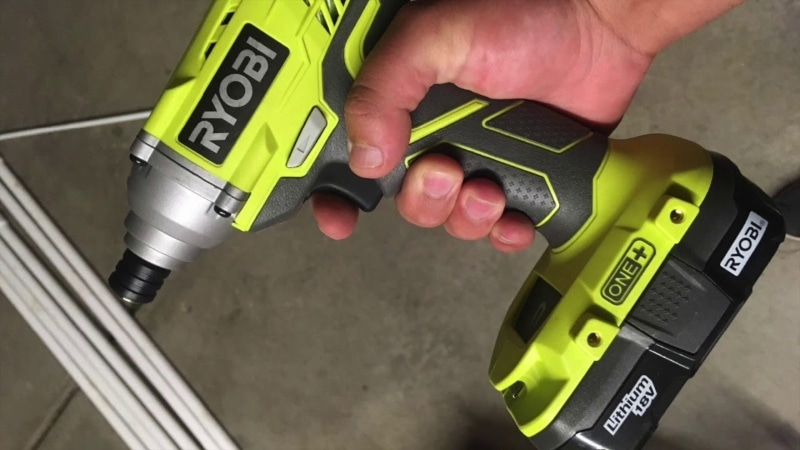 Man working with P235 Impact Driver