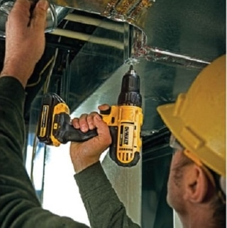 A worker using a DCD771 Drill/Driver