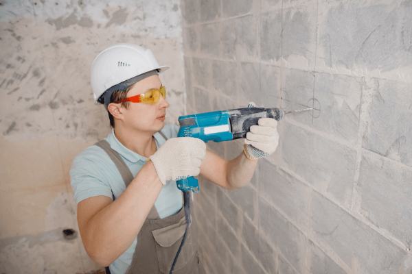 How to use a hammer drill and mark holes for drilling