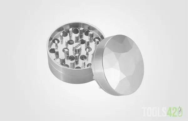 The Brilliant Cut grinder apart displaying its diamond teeth