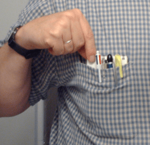 Al's shirt pocket with writing tools