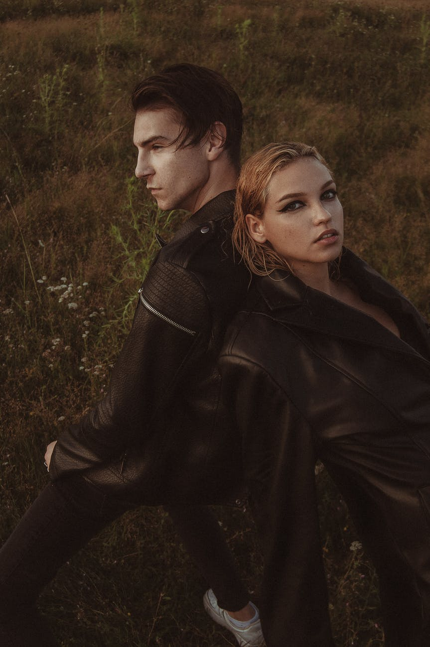 stylish couple in leather clothes in nature