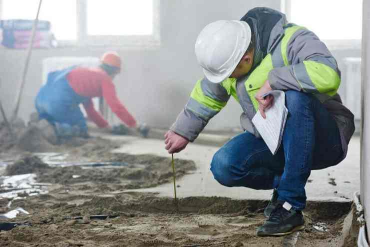 Worker measuring the floor