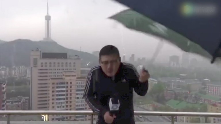 News anchor almost hit by lightning