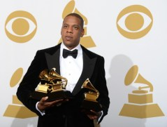 jay-z-poses-in-the-press-room-with-his-trophies-at-the-staples-center-during-the-55th-grammy-awards-_610x464_17