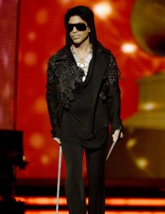 prince_speaks_onstage_during_the_55th_annual_grammy_awards_420x545_2