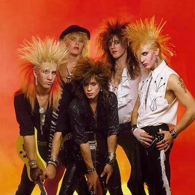 heavy metal band Whitesnake posing for promo images circa 1980's
