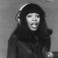 Publicity photo of singer Donna Summer in the recording studio in 1977.