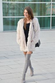 flyffy coat and over the knee boots