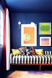 patterned pillows and striped sofa