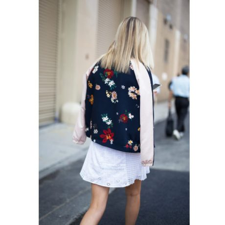 white eyelet dress with bomber jacket