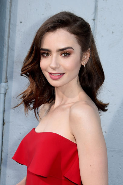 "LOS ANGELES, CA - JULY 27: Actress Lily Collins arrives at the premiere of Amazon Studios' ""The Last Tycoon"" at the Harmony Theatre on July 27, 2017 in Los Angeles, California. (Photo by Kevin Winter/Getty Images)"