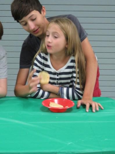 Isabel Jones being fed by Jackson Jones.