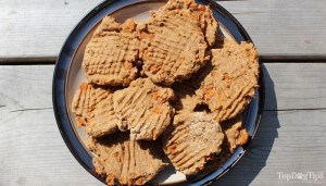 You don't need to worry about placing the biscuits far apart. There is no rising agent, like yeast, in this recipe, so the biscuits won't rise and stick together.