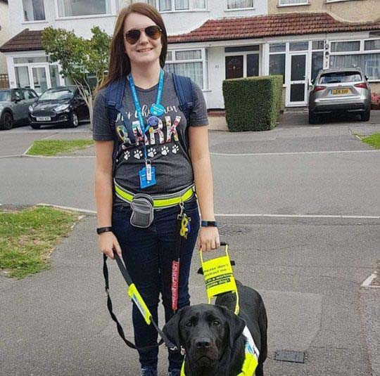 Megan Taylor with her guide dog