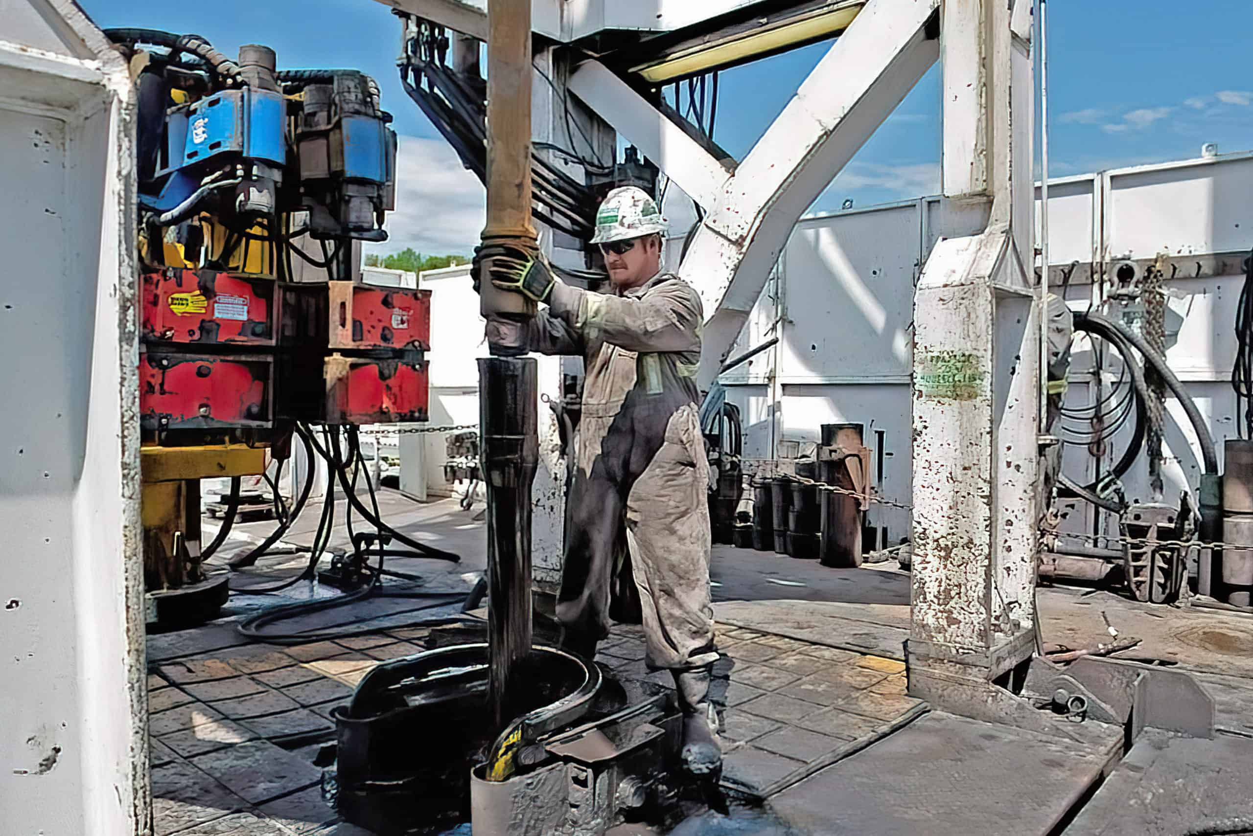 A driller connects two pipes