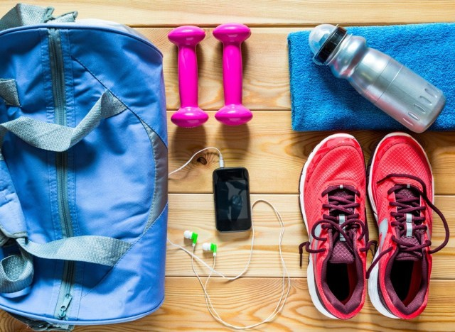 Gym bag weights sneakers shoes water bottle phone music
