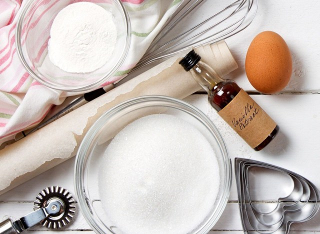 bowl of vanilla extract with rolling pin and cookie cutter