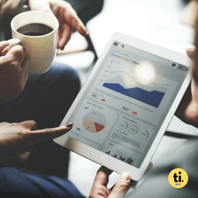 People analyzing charts and graphics from a tablet to represent data analytics in business