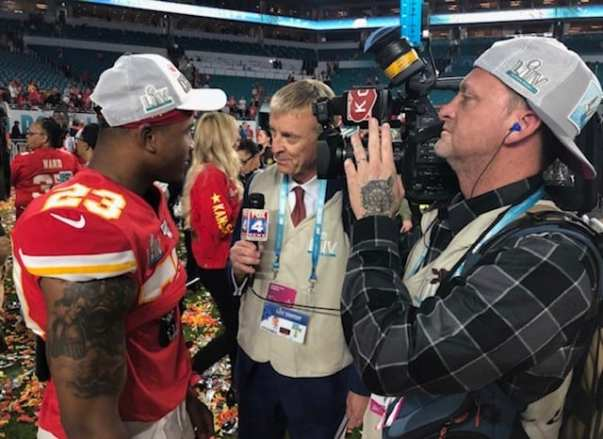 Journalist and Chief's fan John Holt interviewing Armani Watts during the Miami Super Bowl LIV coverage during the post-game coverage, sharing his career opportunities