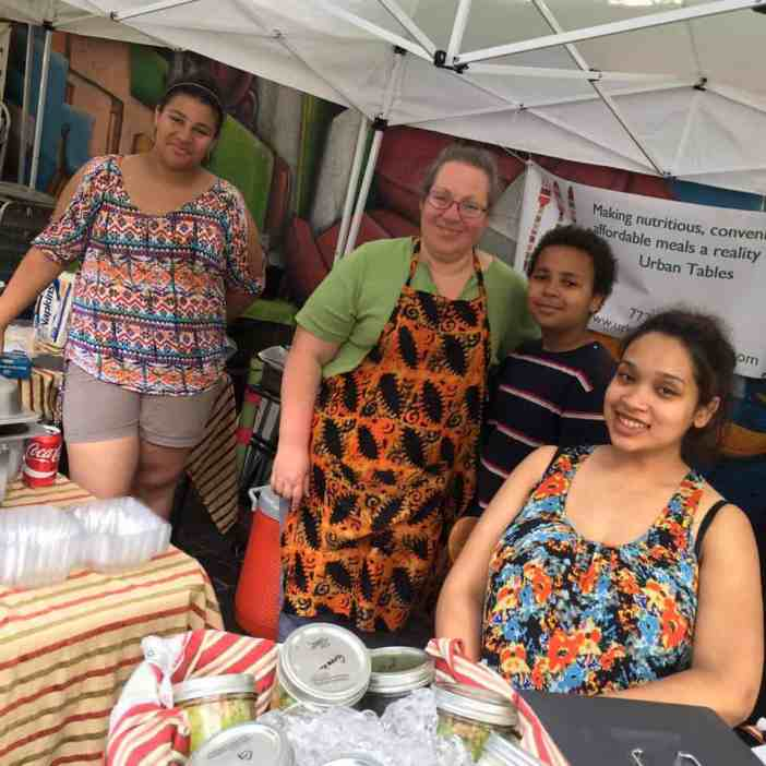 Autumn Williams, Founder of Urban Tables, with her family at their Chicago Farmers' Market station