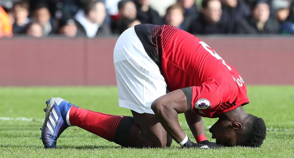 Paul Pogba prostrating after scoring for Manchester United