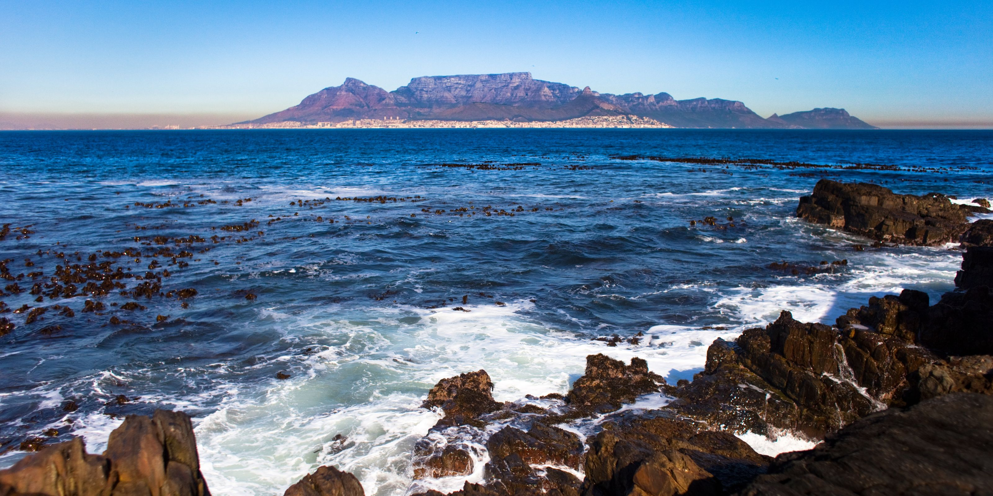 An image of a rocky coastline with another island out to see on the Cape Town SEO agency page.