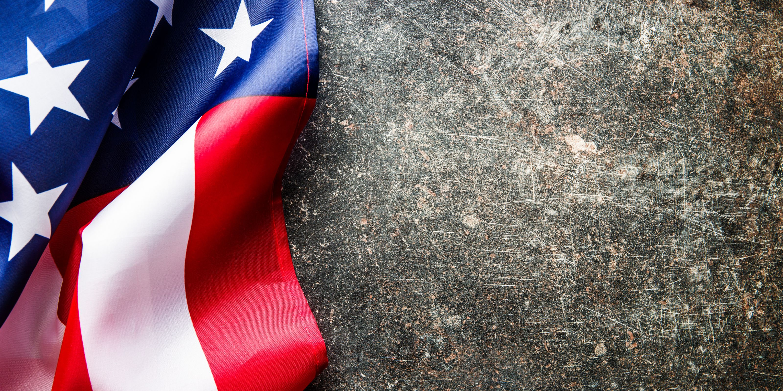 A picture of a section of the american flag on a dark grey background on the US PR agency page.