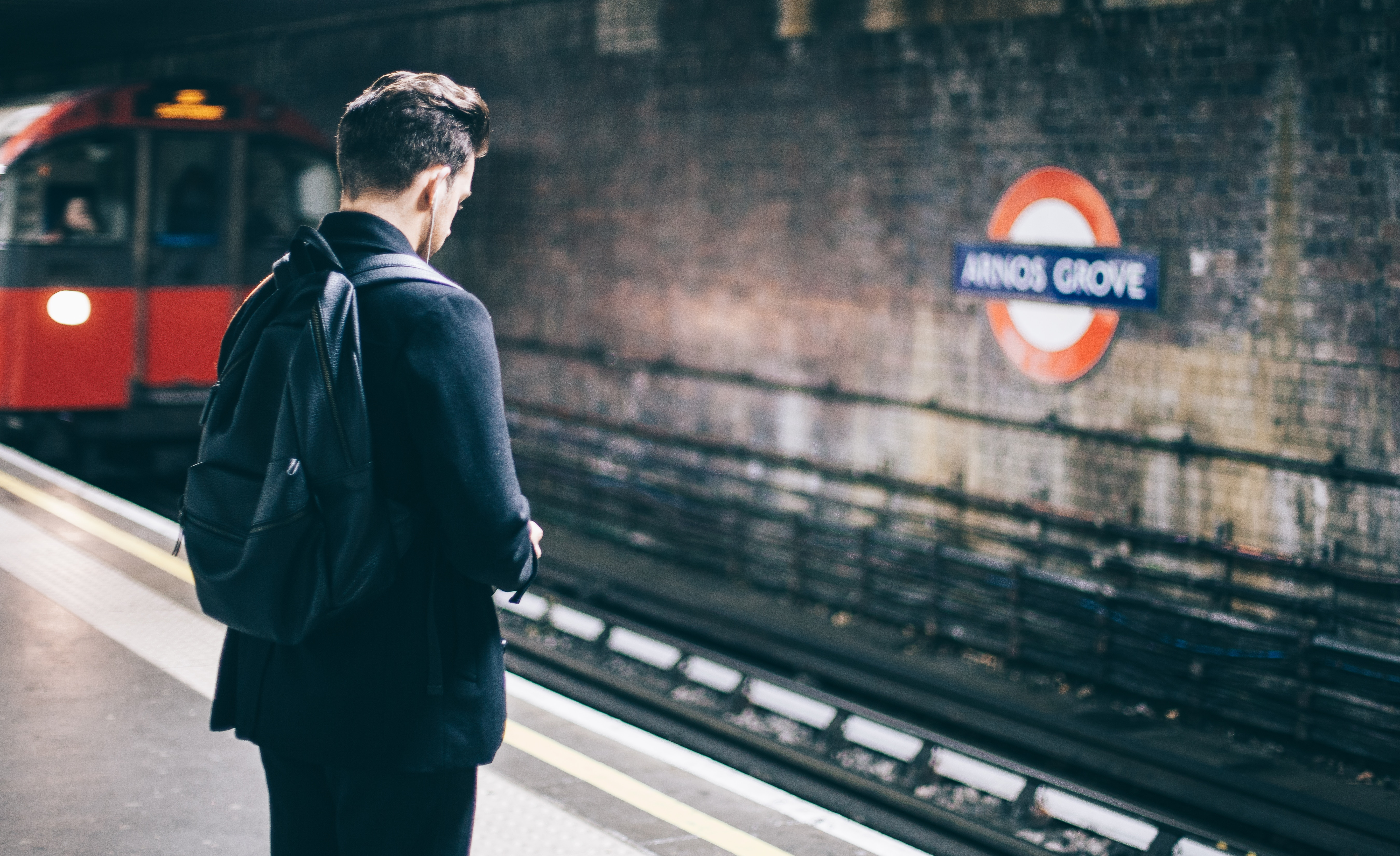 A man waiting for the tube - sustainable film production.