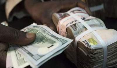 Naira sustains loss against dollar, sells at N410