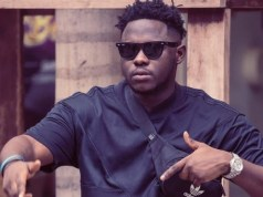 Fan tattoos Medikal on his neck