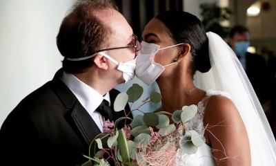 Newlyweds kiss via protective masks in Italy [PHOTOS]
