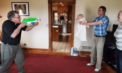 Adorable moment baby gets 'social distancing' baptism
