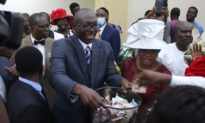Ize-Iyamu-collecting-Thanksgiving-offering-in-the-church-