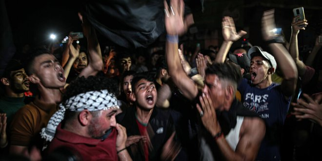 Hamas supporters declare 'victory' in a Gaza City celebration.