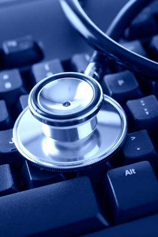 Stethoscope resting on computer keyboard