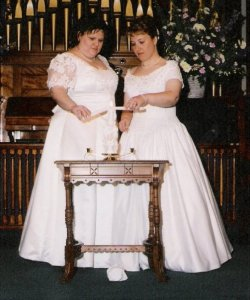 Lighting the Unity Candle on April 28, 2001 - our first wedding. (Look how young I was!)