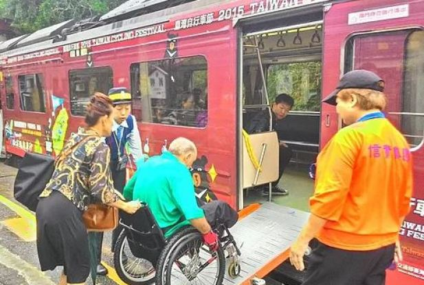 TRA train staffs help to arrange the ramp for wheelchair users getting on/off the train.