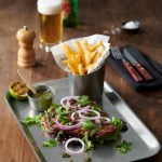Vintage Stainless Steel Rectangular Meal Tray with a beef fillet on top and fries