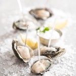Crystal clear Prism Skewers and Oysters over rock salt